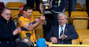 Clare's Gary Brennan lifts the McGrath Cup. Photograph: Ryan Byrne/Inpho