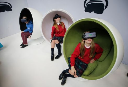 BT Young Scientist & Technologist of the Year 2019 (Day 2). In the World of Science and Technology area (from left) Rose Martin, St.  Fiachra's Beaumont; Naoise Clarke Carr, Ratoath College and Helena Lund, Ratoath College, Meath enjoying the Virtual Reality display at the show.  Photograph Nick Bradshaw for The Irish Times