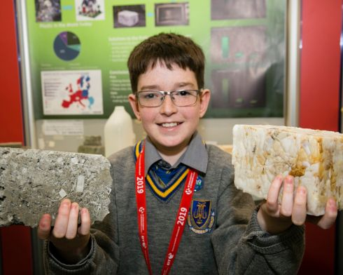 Cian O'Brien from Marist College Westmeath with his project 'Can Recycled Bricks Solve the Housing Crisis'? at the 55th BT Young Scientist and Technology Exhibition 2019 Photo; Johnny Bambury/Fennells