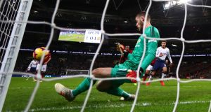 Manchester United goalkeeper David De Gea   makes a save during the Premier League match against Tottenham Hotspur  at Wembley. Photograph: Clive Rose/Getty Images