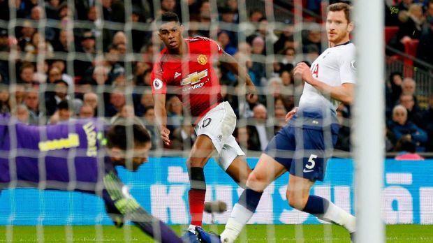 Manchester United striker Marcus Rashford shoots past Tottenham Hotspur goalkeeper Hugo Lloris to score in the Premier League match at Wembley. Photograph: Ian Kington/Ikimages/AFP