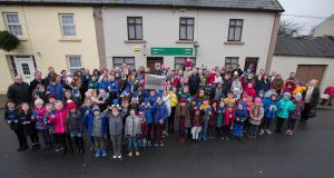 DEMONSTRATION: More than 100 people gathered at Gurteen post office on Sunday morning, Janauary 13th, for a show of support for the campaign against the closure of the outlet in the Co Sligo town. Photograph: Brian Farrell/The Irish Times