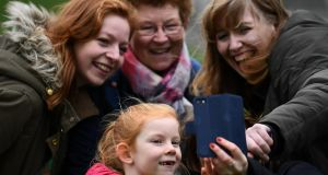 People with red hair, including Aishling Griffiths (7) take a selfie to celebrate 'Kiss a Ginger Day' on the 10-year anniversary of this anti-bullying day, in Dublin on Saturday. Photograph: Clodagh Kilcoyne