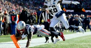 Sony Michel of the New England Patriots scores a touchdown during the first quarter of the AFC divisional playoff  against the  Los Angeles Chargers Game at Gillette Stadium  in Foxborough, Massachusetts. Photograph: Adam Glanzman/Getty Images