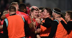 Jacob Stockdale of Ulster is mobbed by team mates after scoring a try against Racing 92 at Kingspan Stadium. Photograph: Charles McQuillan/Getty Images