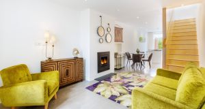 The living area at 17 Library Road in Dún Laoghaire – seating to the front before an inset woodburner, dining in the middle and contemporary fitted kitchen to the rear – has a polished concrete floor.