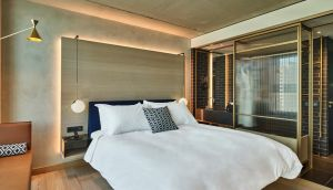 Bedroom at Urban Hotel QO in Amsterdam, designed by Tank Architecture & Interior Design, Conran&Partners in association with IHG's interior design department