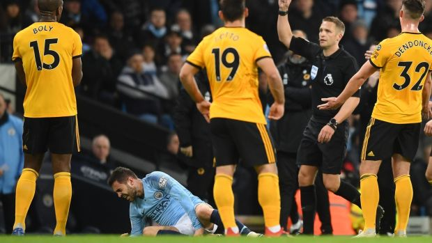 Willy Boly is shown a red card by referee Craig Pawson. Photo: Michael Regan/Getty Images