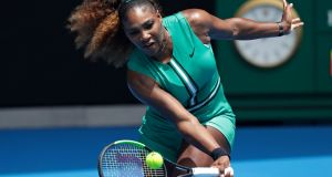 Serena Williams hits a forehand return to Germany's Tatjana Maria during their first round match at the Australian Open. Photograph: AP