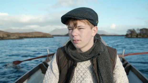 Paddy Doran wearing a tweed cap from Mucros Weaver, scarf by Aine and sweater from West End Knitwear with gilet by de Bruir. Film still: Perry Ogden/Showcase 2019