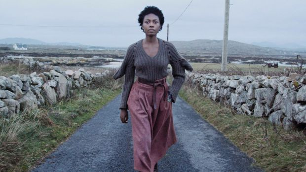 Somto in Fintan Mullholland knit, skirt by Bernie Murphy, belt by de Bruit and earrings by Chupi. Film still: Perry Ogden/Showcase 2019