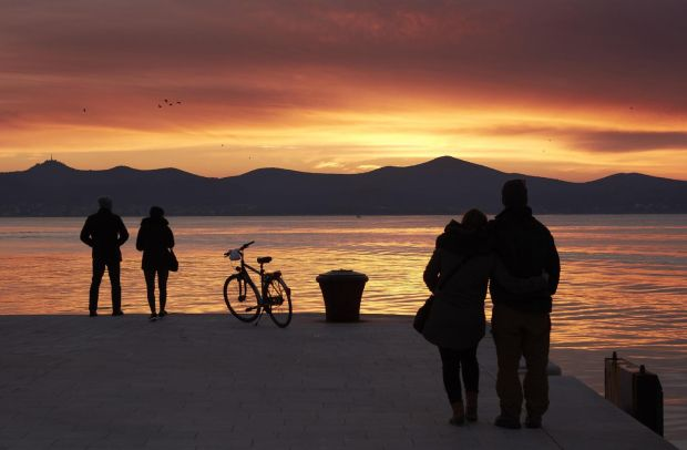 Sunset along the waterfront in Zadar, Croatia. In 1964, Alfred Hitchcock said he'd witnessed the most beautiful sunset in the world there. Photograph: Andy Haslam/The New York Times