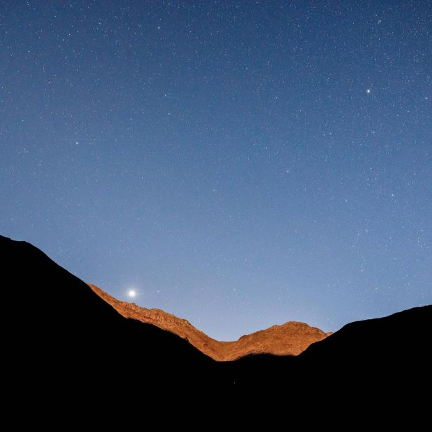 Venus rising over the mountains before sunrise in the Elqui Valley in Chile. Photograph: Tomas Munita/The New York Times