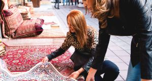 Buying carpets in Istanbul. Photograph: Getty