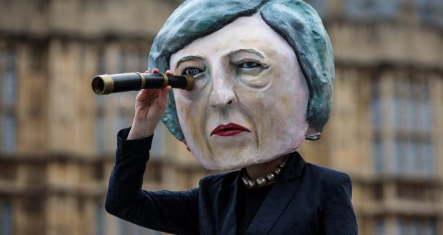 A demonstration featuring a paper mâché Theresa May outside the Houses of Parliament in London. Photograph: Jack Taylor/Getty