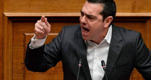 Greek prime minister Alexis Tsipras speaking in parliament on Tuesday.  He is expected to retain power and press on with ratification of the accord. Photograph: Louisa Gouliamaki/AFP/Getty Images
