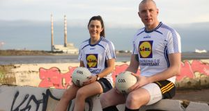 Former Kerry star Kieran Donaghy and Dublin All-Ireland winner Lyndsey Davey Pictured at Dublin's Sandymount Strand for the launch of the Lidl Comórtas Peile Páidi Ó Sé 2019 GAA Football Festival, which takes place in the Dingle Peninsula from 15th to 17th February. Photograph: Thomas White