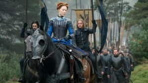 Saoirse Ronan rides out in armour that matches her blue eyes