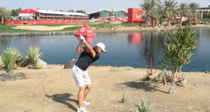 Tommy Fleetwood plays a shot on the 18th hole during a practice round ahead of the Abu Dhabi HSBC Golf Championship at the Abu Dhabi Golf Club. Photo: Warren Little/Getty Images