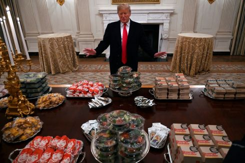 US president Donald Trump talks to the media about the table full of fast food in the State Dining Room of the White House in Washington for the reception for the Clemson Tigers. Photograph: Susan Walsh/AP