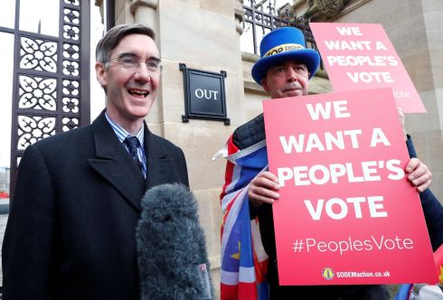 Tory Brexiteer Jacob Rees-Mogg talks to the media next to an anti-Brexit protester outside the Houses of Parliament. Photograph: Eddie Keogh/Reuters
