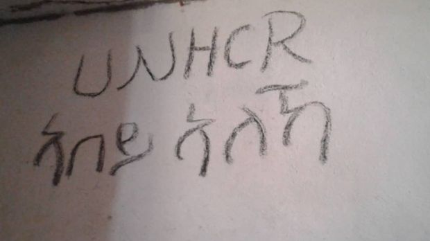 """Where is UNHCR?"" written on the wall in the Souq al Khamis detention centre in Khoms."