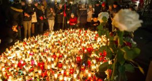 People mourn the mayor of Gdansk, Pawel Adamowicz, who died on Monday from stab wounds received at a charity event. Photograph: Wojciech Strozyk/AP