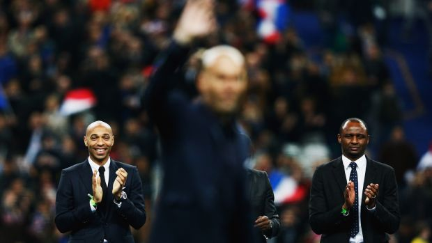 Henry and Vieira applaud Zinedine Zidane. Photo: Dean Mouhtaropoulos/Getty Images