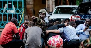 Special forces protect people at the scene of an explosion at a hotel complex in Nairobi. Photograph: Luis Tato/AFP/Getty Images