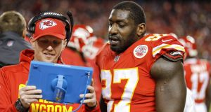 Kansas City Chiefs  defensive line coach Britt Reid with Allen Bailey during a game against the Oakland Raiders at Arrowhead Stadium  in Kansas City, Missouri, in December. Photograph: David Eulitt/Getty Images