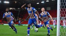 Fejiri Okenabirhie of Shrewsbury Town celebrates after scoring his side's second goal during the FA Cup third round replay against Stoke City. Photo: Nathan Stirk/Getty Images