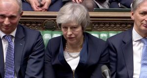 UK prime minister Theresa May in Parliament after the vote on her Brexit deal. Photograph: Reuters
