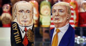 Russian dolls in the likeness of Russia's president Vladimir Putin and US presidential candidate Donald Trump. Photograph: Mikhail Pochuyev/TASS  via Getty Images