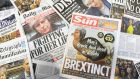 "An arrangement of daily newspapers photographed in London on January 16, 2019 shows front pages reporting on the UK parliament's rejection of the government's Brexit deal. - Prime Minister Theresa May was left ""crushed"" and ""humiliated"", Britain's newspapers said on January 16 as they raked over the fallout from parliament's huge rejection of her EU divorce deal. (Photo by DANIEL SORABJI / AFP)DANIEL SORABJI/AFP/Getty Images"