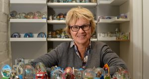 Bernadine Grogan, from Palmerstown, Dublin, with some of her snow globe collection. Photograph: Dara Mac Dónaill