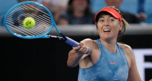 Maria Sharapova makes a forehand return to Sweden's Rebecca Peterson during their second round match at the Australian Open in Melbourne, Australia. Photograph: Aaron Favila/AP