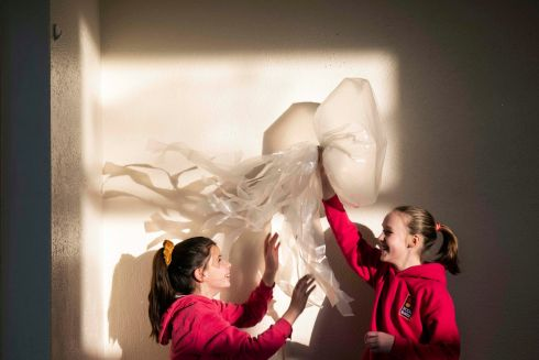 PICK OF THE LITTER: Caoimhe Mc Sweeney and Caoimhe Ní Bheara pictured with their piece as part of a primary school art initiative to highlight marine litter. Photograph: Clare Keogh