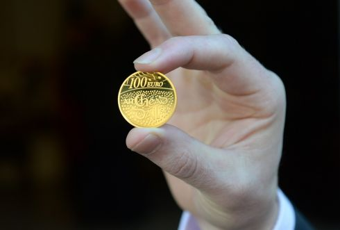 COINING IT: The new €100 collector's coin to commemorate the centenary of the meeting of the first Dáil. Photograph: Dara Mac Dónaill/The Irish Times