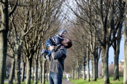 GIVE A LIFT: Andrew Rutkunas and his son Jacob out for a walk along the Grand Canal in Dublin. Photograph: Alan Betson/The Irish Times