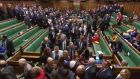 A video grab from footage broadcast by the UK Parliament's Parliamentary Recording Unit (PRU) shows Members of Parliament filing out of the House of Commons chamber to vote on a motion of no confidence in the government. Photograph: HO / PRU / AFP