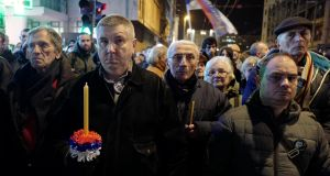 People attend a march in Belgrade, Serbia  on the first anniversary of the murder of opposition Serb politician Oliver Ivanovic   in the town of Mitrovica in Kosovo. Photograph: Kevin Coombs/Reuters