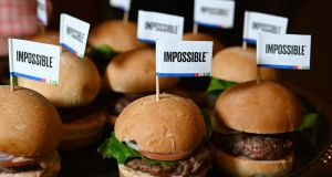 The Impossible Burger 2.0, a plant-based vegan burger that tastes like real beef is introduced at  CES 2019 in Las Vegas. Photograph:  Robyn Beck/AFP/Getty Images