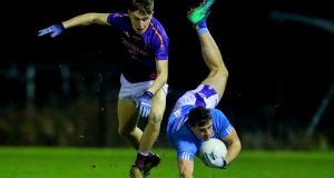 DIT's Brian Howard is tackled by Eoghan Lawless of UL during their Sigerson Cup clash. Photo: Oisin Keniry/Inpho
