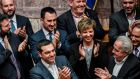 Greek prime minister Alexis Tsipras and members of his government applaud after winning a confidence vote in the parliament in Athens on Wednesday. Photograph: Louisa Gouliamaki/AFP/Getty Images