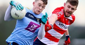 CIT's Cian O'Connor challenges Mike Lordan of UCD. Photograph: Tommy Dickson/Inpho