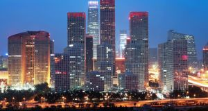 Beijing by night. The immigrant investor scheme is simple. Make the investment, visit Ireland once a year, and you and yours are entitled to an Irish residency permit for five years, renewable – forever.