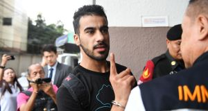 Hakeem al-Araibi, a former Bahrain national team footballer with refugee status in Australia, is escorted by immigration police to a court in Bangkok on December 11th, 2018. Photograph: Lillian Suwanrumpha/AFP