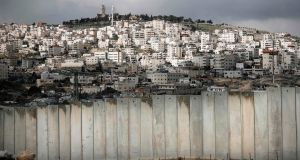 The controversial Israeli separation barrier separating the Palestinian West Bank village of Eizariya (foreground) and Jerusalem (background). Photograph: Thomas Coex/AFP/Getty Images