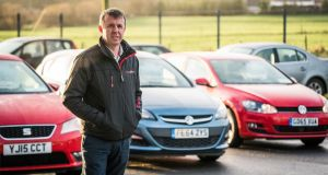 Kieran Whelton with some of his UK imported secondhand cars at his car dealership in Knock, Co Mayo. Photograph: Keith Heneghan