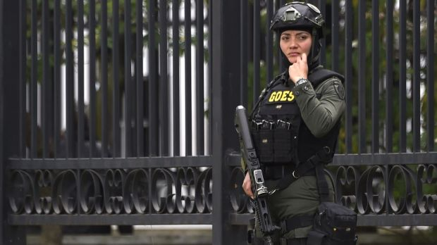 A member of the security forces stands guard at the explossion site. Photograph: Juan Barreto/AFP/Getty Images